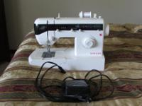 Type: For Sale Sewing Machine and Case. They are in