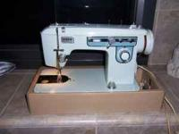 The is a solid steel Sewing Machine made by brother. It