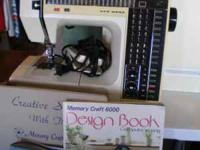 VERY NICE MEMORY CRAFT SEWING MACHINE WITH DIRECTION