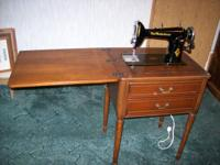 1920's - sewing machine and cabinet in excellant