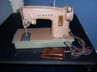 Singer Sewing machine with foot pedal. Works well Call