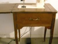Singer sewing machine with wood cabinet for sale. Works