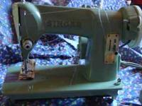 Singer Sewing Machine 185K $100.00.  Location: AVL +