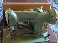 Singer Sewing Machine 185K In Case $175.00.  Location: