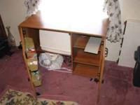 I have a good - very lightly used sewing table with two