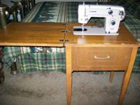 Nice sewing machine and cabinet for sale older but most