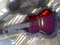 NEW PRICE ...Cherry red wood grain color . This Guitar