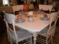 Shabby chic table and 4 large, highback chairs. Very