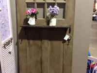 Re-purposed antique door to make use of as a decorative