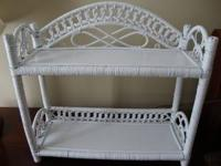 This adorable two shelf accessory piece can be hung,