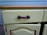 beautiful cabinet with red ruby vintage glass knobs,
