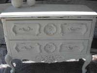 This is a Drexel chest of drawers painted in a creamy
