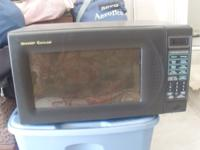I AM SELLING MY MICROWAVE $ 20 LAWN MOVER $ 45 CHAIR $