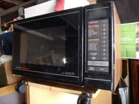 SHARP MICROWAVE WITH SENSOR. WORKS PERFECTLY. FOR