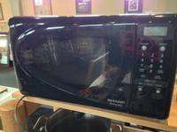 We have a nice Sharp Carousel microwave, model R-209HK,