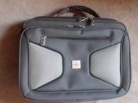 Sharper image laptop case with lots of storage. Fits up