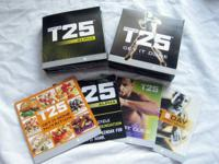 Shaun T's FOCUS T25 9-Disc DVD Workout. Open box set