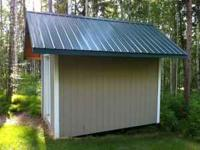 12.5 ft x 8.5 ft shed with vynal siding and steel roof.