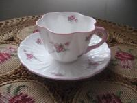 This dainty teacup and saucer have a lovely soft pink