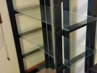 We have a pair of glass racks with wooden frames. The