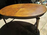 A solid wood dinning table in dark walnut color with a
