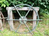 Matching iron wheels in solid condition, one of them