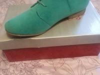 I have a pair of mint color shoes for sale! They have
