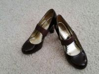 Brown patent leather pumps with 31/4 inch heel.