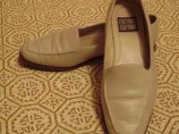 There are two pair of womens size 10 W slip on shoes.