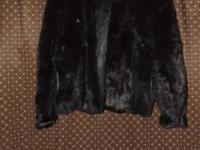 This is a short waist 100% rabbit fur jacket. Made with