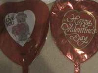 Mylar balloons with various love and valentines