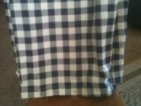 This is a navy & cream checkered used shower curtain.