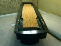 Dark wood shuffleboard table. No scratches, excellent