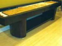 Wooden shuffleboard table in excellent condition would