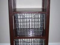 side table with 2 silver wire baskets. Comes from a