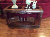 Beautiful side table in new condition.  Glass inserts