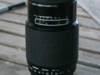 This is a Sigma75-300mm zoom f 4.5-5.6, auto focus