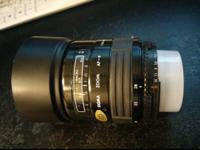 Autofocus zoom lens by Sigma for, I believe, Canon