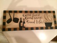 Selling a small sign Good Food Good Wine Good Life!