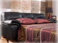 The rich faux leather upholstery and plush comfortable
