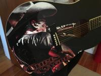 This is a Johnson brand guitar with Chris Cagle on it.
