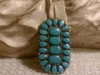 This American Indian ring has 20 teardrop turquoise