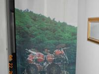 Rare banner of Neil Peart playing his red TAMA kit on a