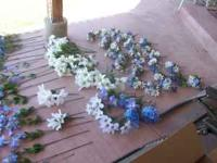 Various Blue silk flowers totaling 71. Used once to