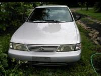 Silver 1995 Nissan Sentra 4 door. Mechanics special or