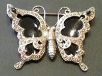 This lovely silver and black onyx butterfly pin is