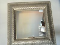 Beautiful silver carved mirror. 36x36 I actually have