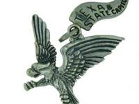 This charm is an eagle in flight with its legs hanging