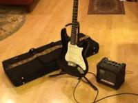 A Silvertone electric guitar, Micro Cube amp by