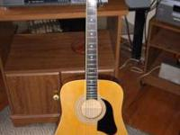 Guitar Silvertone accoustic, like new , first $100.